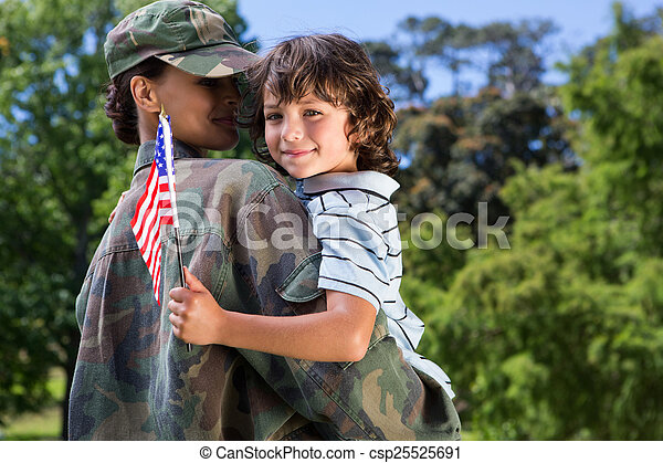 Soldier reunited with her son - csp25525691