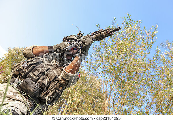 soldier shooting during the military operation  - csp23184295