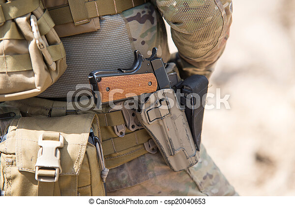 Soldiers in US Army Special Forces uniform, close up on pistol - csp20040653