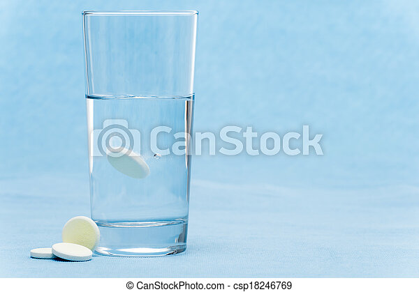 Soluble tablet throw in water glass - csp18246769
