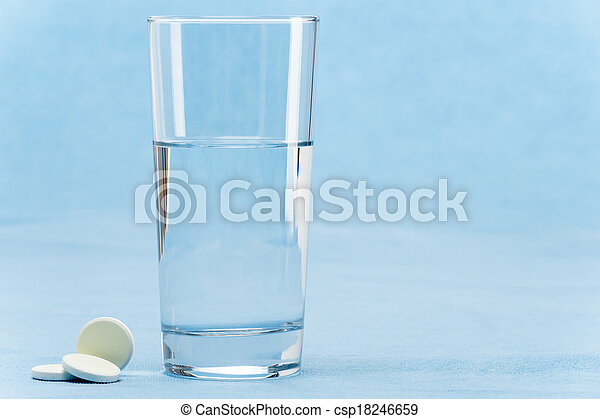 Soluble tablet throw in water glass - csp18246659