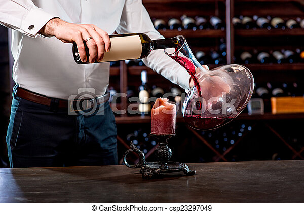 Sommelier in the wine cellar - csp23297049