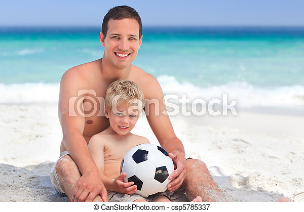 Son playing football with his father - csp5785337