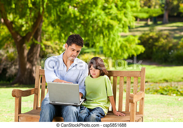 Son with his father looking at thei - csp5851688