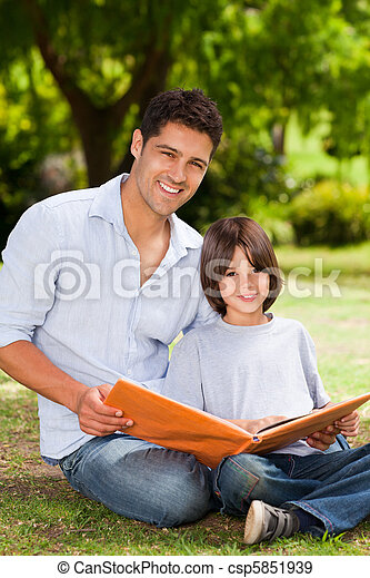Son with his father looking at thei - csp5851939