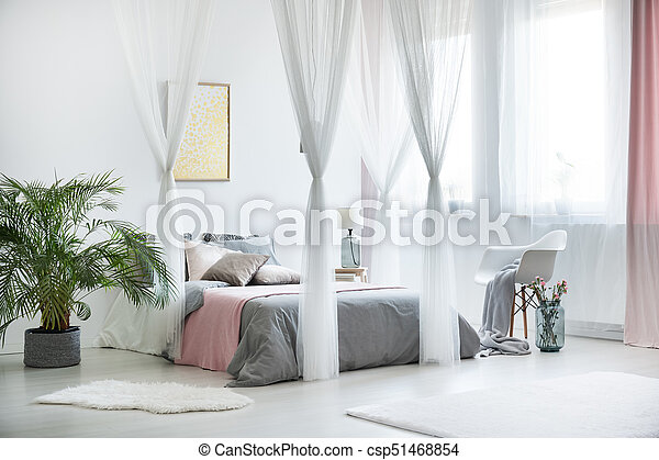 Sophisticated bedroom interior with plant - csp51468854