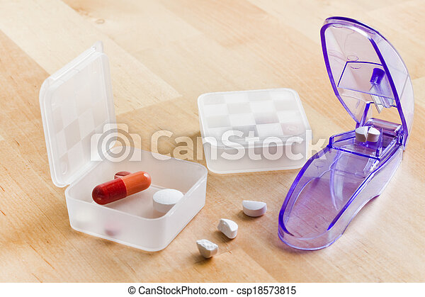 Sorting out medication in pillboxes using pillcutter - csp18573815