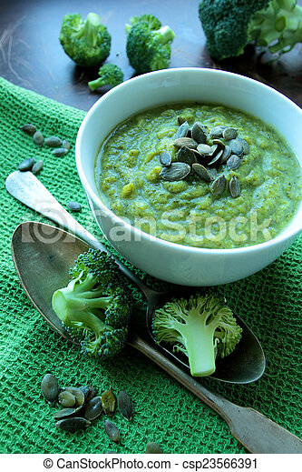 Soup of fresh broccoli with pumpkin seeds - csp23566391
