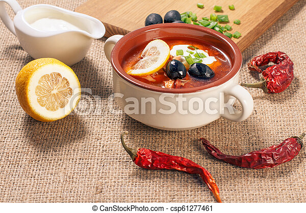Soup saltwort with meat, potatoes, tomatoes, lemon and black olives - csp61277461
