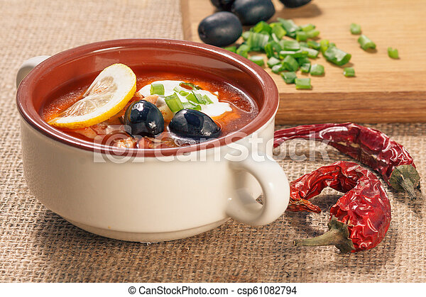 Soup saltwort with meat, potatoes, tomatoes, lemon and black olives - csp61082794