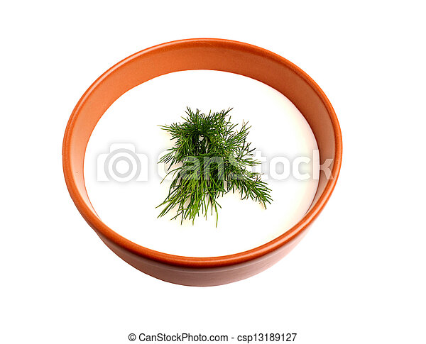 Sour cream and dill in a bowl - csp13189127