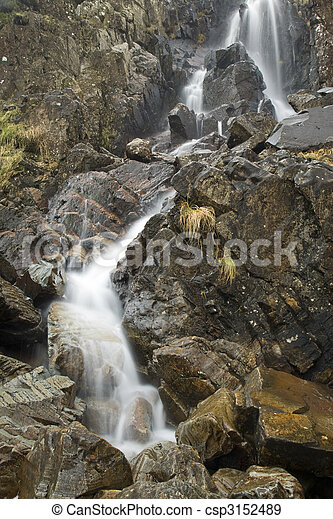 Sour Milk Gill as it falls from the fells near Seathwaite on the path to Great Gable, Lake District, Cumbria, Uk - csp3152489