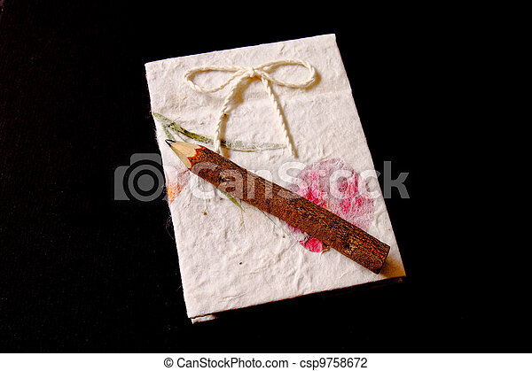 souvenir wood pencil with natural notebook on black background - csp9758672