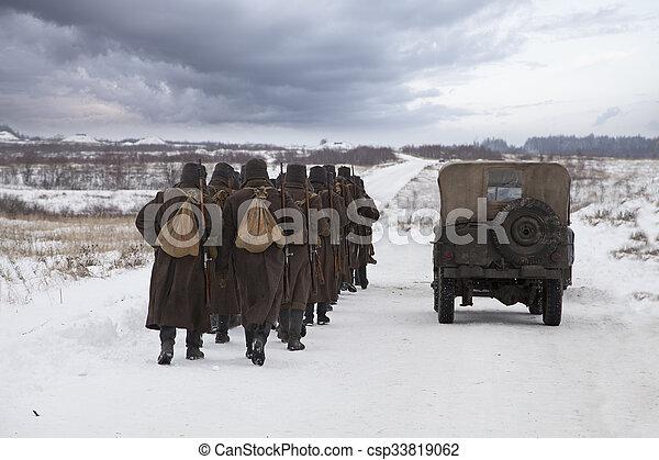 Soviet soldiers in a winter field - csp33819062