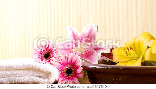 spa background of flowers stones and towel