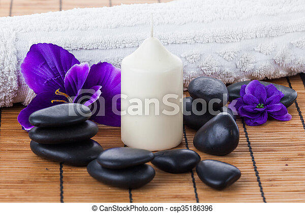 spa concept zen stones candles and flowers