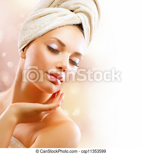Spa Girl. Beautiful Young Woman After Bath Touching Her Face - csp11353599