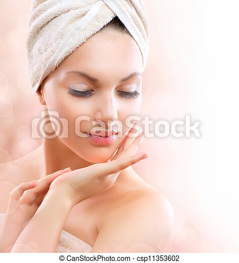 Spa Girl. Beautiful Young Woman After Bath Touching Her Face  - csp11353602