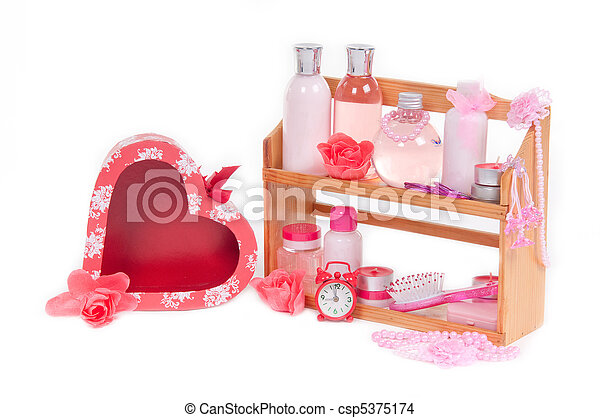 SPA present and red heart shaped gift box isolated on white - csp5375174