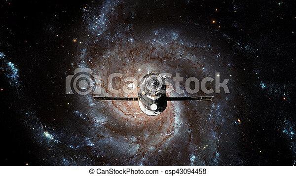 Spacecraft Progress orbiting the galaxy. - csp43094458