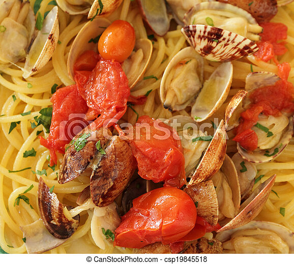 Spaghetti alle vongole veraci   -  spaghetti with clams, serving in restaurant in Italy - csp19845518