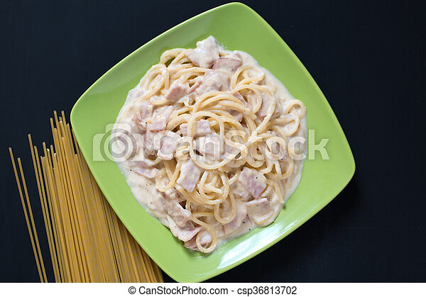 Spaghetti Carbonara with bacon and cheese, top view on black background - csp36813702