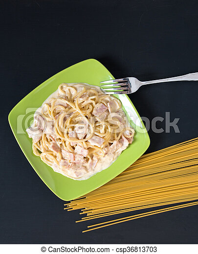 Spaghetti Carbonara with bacon and cheese, top view on black background - csp36813703