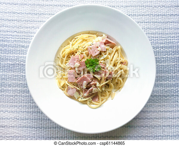 Spaghetti Carbonara with bacon on top view - csp61144865