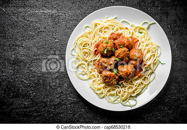 Spaghetti with meat balls on a plate. - csp68530218