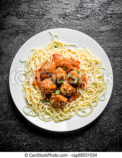 Spaghetti with meat balls on a plate. - csp68531034
