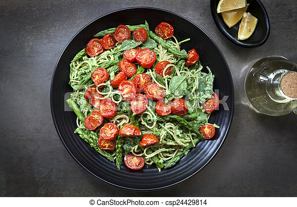 Spaghetti with Roasted Tomatoes and Asparagus Pesto - csp24429814