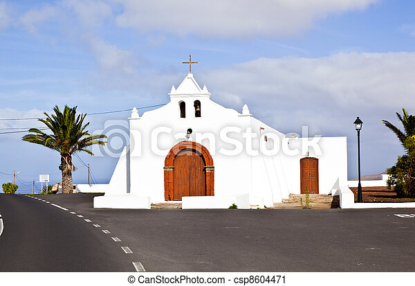 Spain Canary Islands Lanzarote pretty whitewashed chapel overlooking Atlantic Ocean - csp8604471