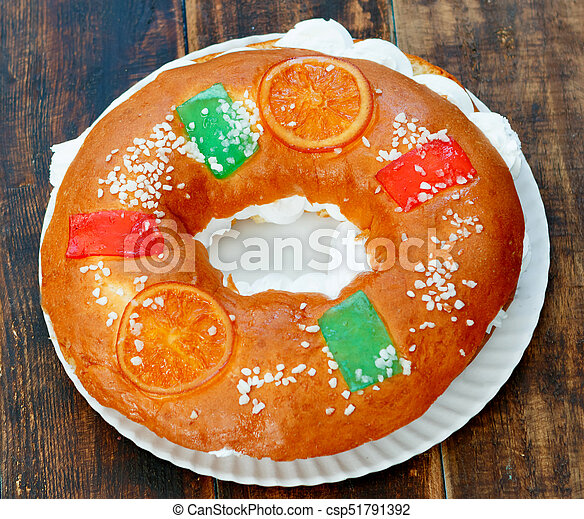 spanish christmas cake with fruits nut and icing on wooden background csp51791392