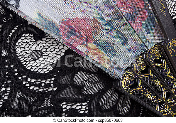 Spanish fan on the background of lace. - csp35070663