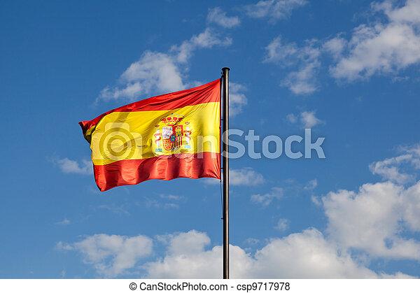 Spanish Flag in a Blue Sky - csp9717978