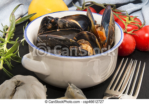 spanish mussels in a bowl with chorizo - csp46612727