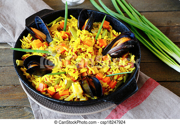 Spanish paella with mussels - csp18247924
