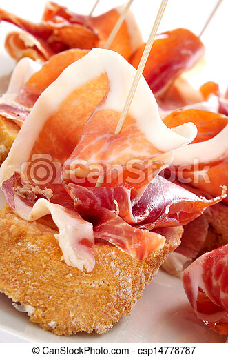 spanish pinchos de jamon, serrano ham served on bread - csp14778787