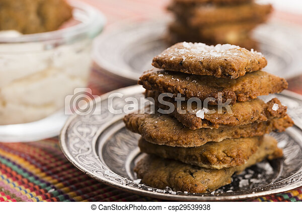 spanish snack crackers with black olives and anchois