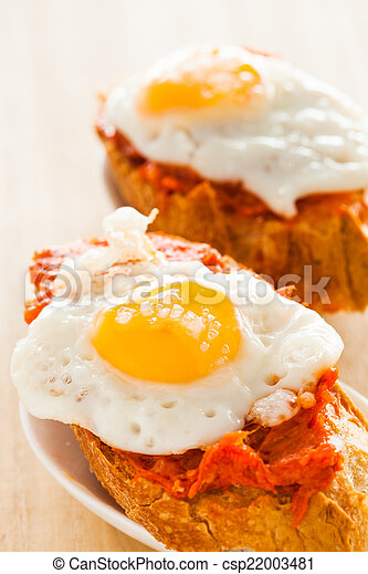 spanish snack typical spanish tapa with quail eggs and sobrasada
