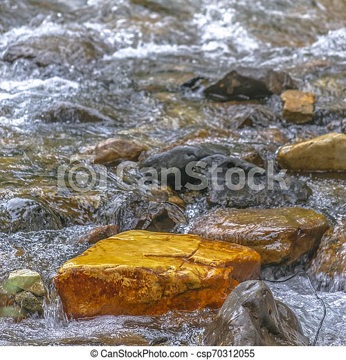 Sparkling clear water flowing on a rocky stream - csp70312055