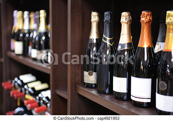 sparkling wine and champagne bottles in a liquor store - csp4921953