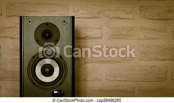 Speakers on the brick wall background - csp38496265