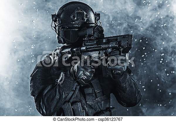 Spec ops police officer swat in the rain.