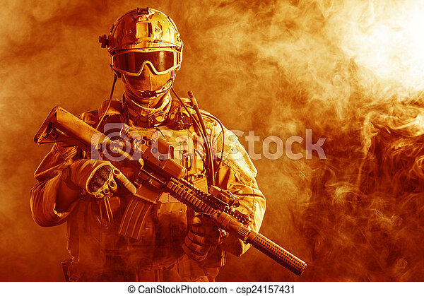 Special forces soldier in the fire - csp24157431