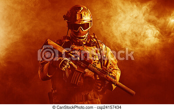 Special forces soldier in the fire - csp24157434
