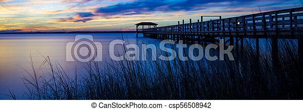 Spectacular sunset at the ocean pier - csp56508942
