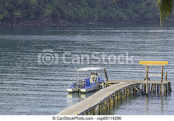 Speed boats moored at the wooden bridge In the summer sea at Koh Kood, Trat in Thailand. - csp69114286
