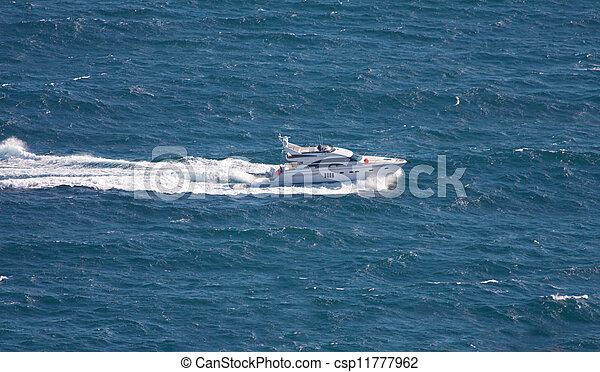speedboat cruising in sea - csp11777962