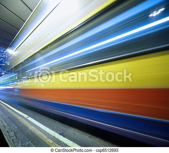 Speeding bus, blurred motion. - csp6512693